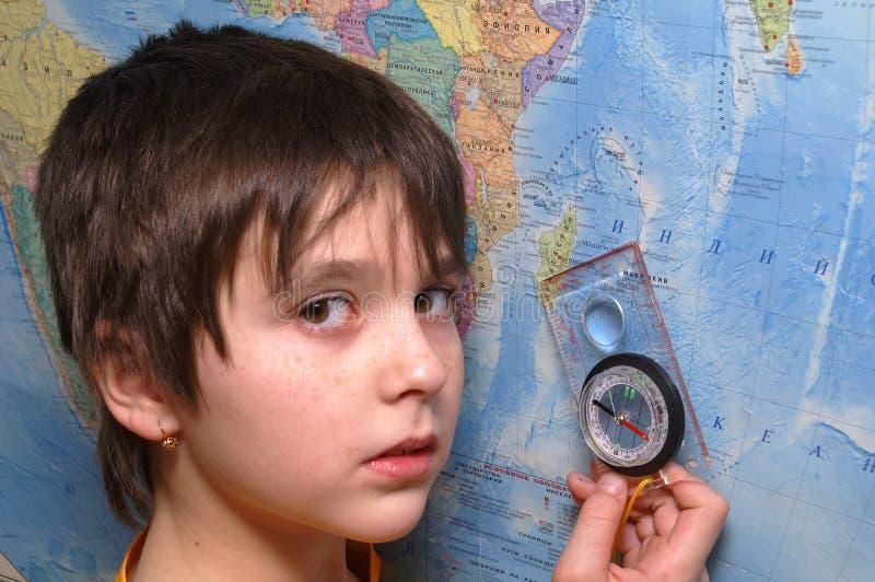 Het meisje en het kompas stock foto's