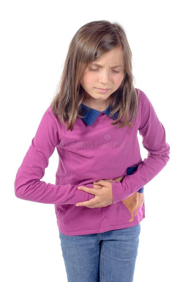 Het meisje heeft een maagpijn stock foto