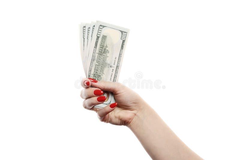 Het meisje houdt heel wat honderd die dollarsrekeningen op witte achtergrond worden geïsoleerd royalty-vrije stock afbeeldingen