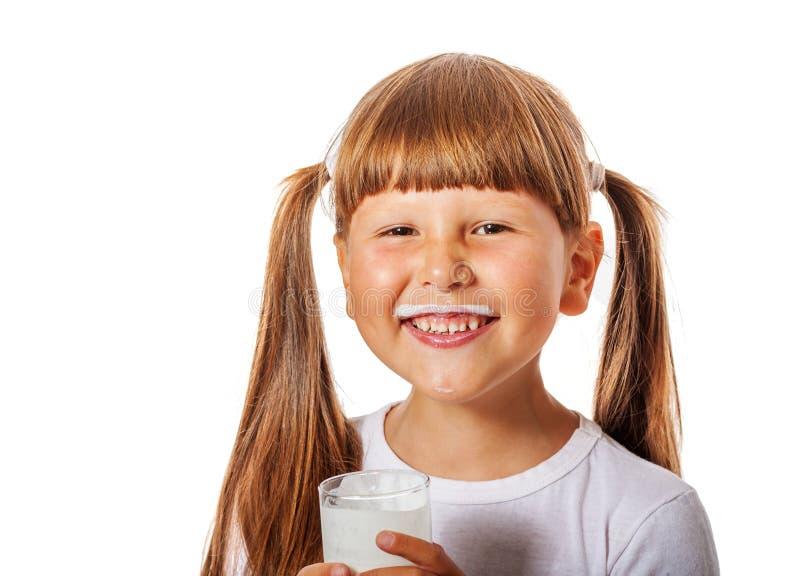 Het meisje houdt van melk stock afbeelding