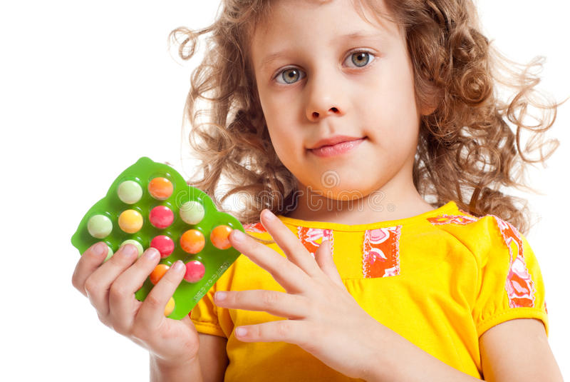 Het meisje houdt vitaminen royalty-vrije stock foto's