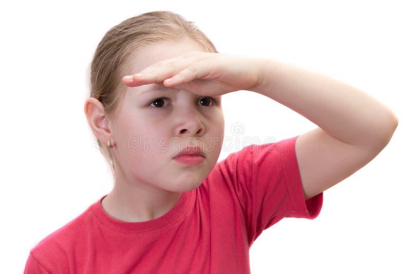 Het meisje kijkt veraflegen stock fotografie