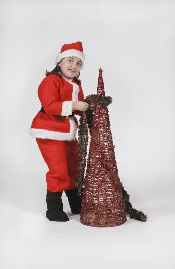Het meisje kleedde zich als Kerstman met Kerstmis royalty-vrije stock foto's