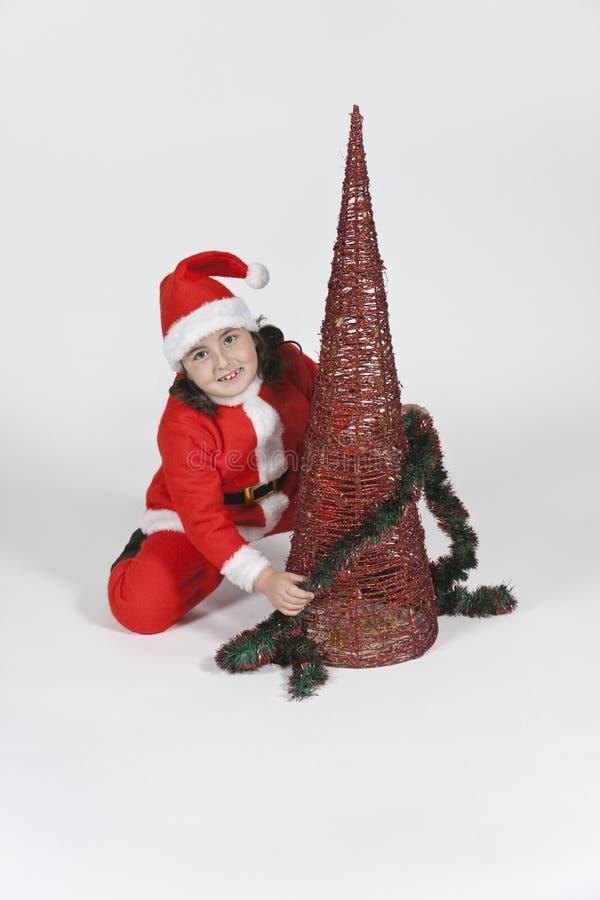 Het meisje kleedde zich als Kerstman met Kerstmis royalty-vrije stock fotografie