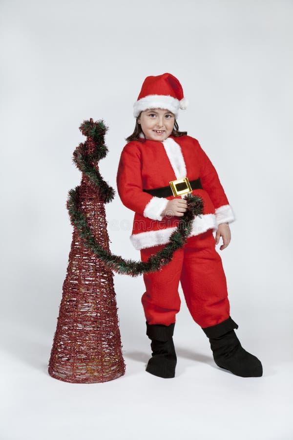 Het meisje kleedde zich als Kerstman met Kerstmis stock afbeeldingen