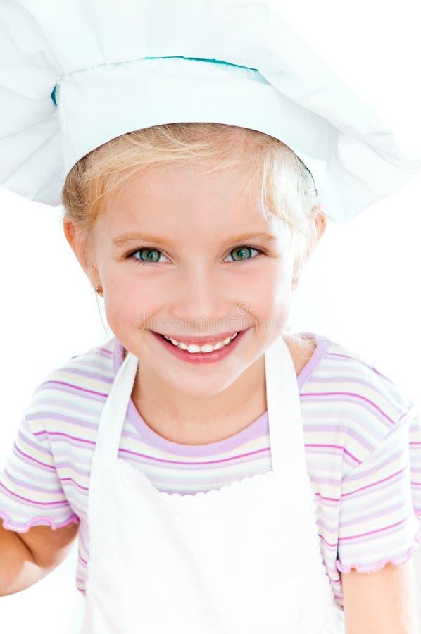 Het meisje kleedde zich als kok stock foto