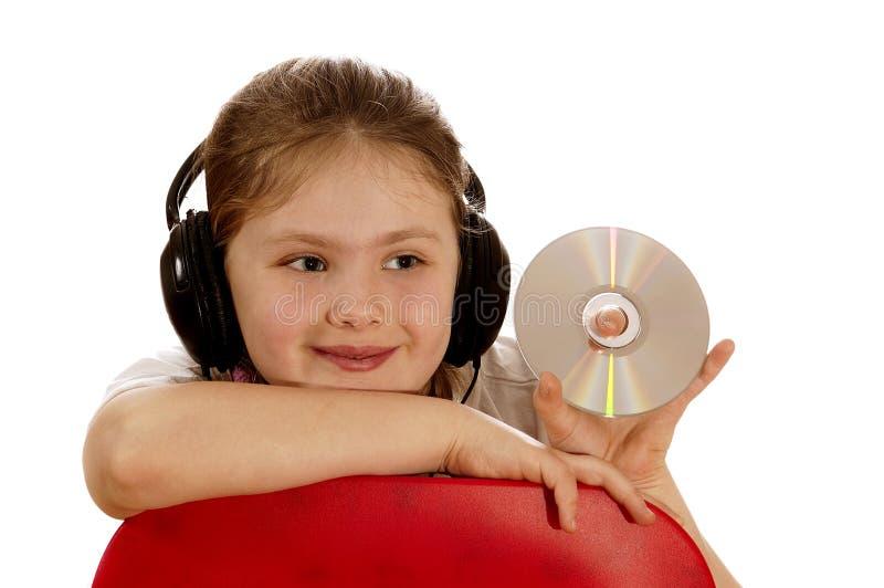 Het meisje luistert aan muziek II. royalty-vrije stock afbeelding