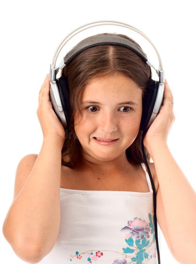 Het meisje luistert een muziek royalty-vrije stock foto's