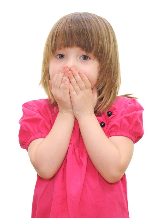 Het meisje met behandelde zijn mond royalty-vrije stock afbeelding