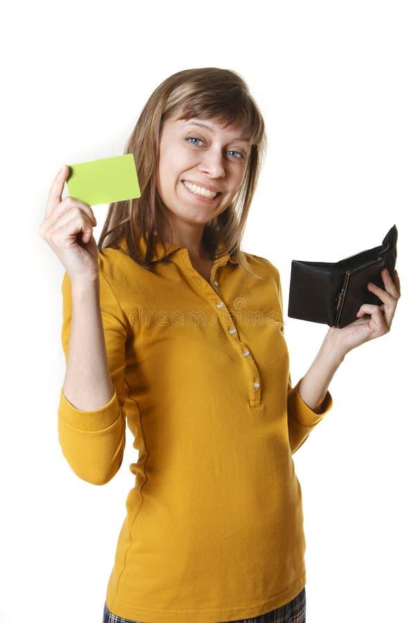 Het meisje met een beurs en een plastic kaart stock afbeeldingen