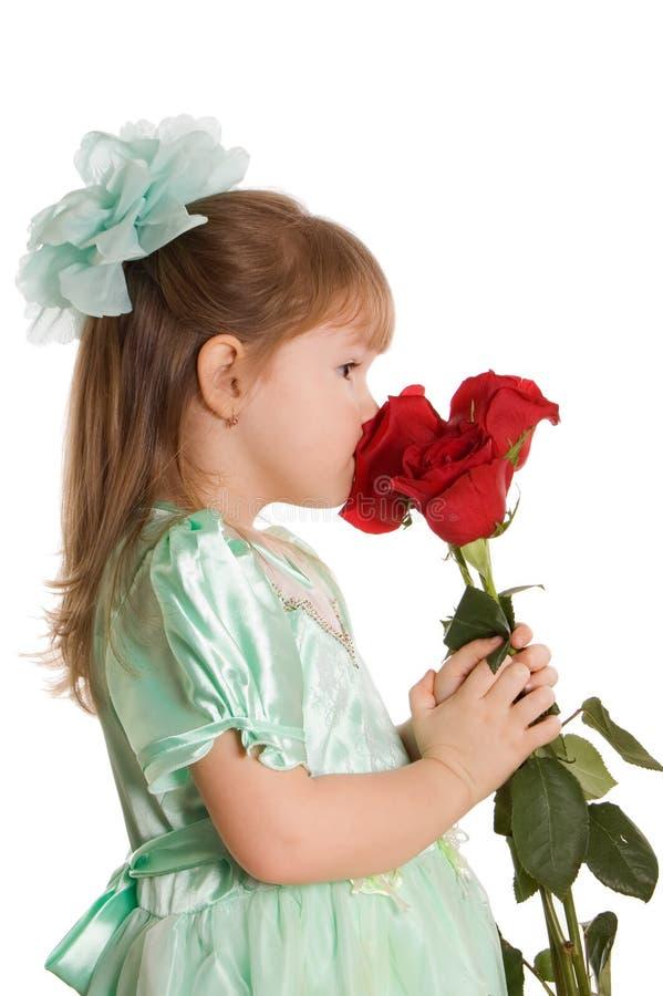 Het meisje met een boeket van rozen stock afbeeldingen