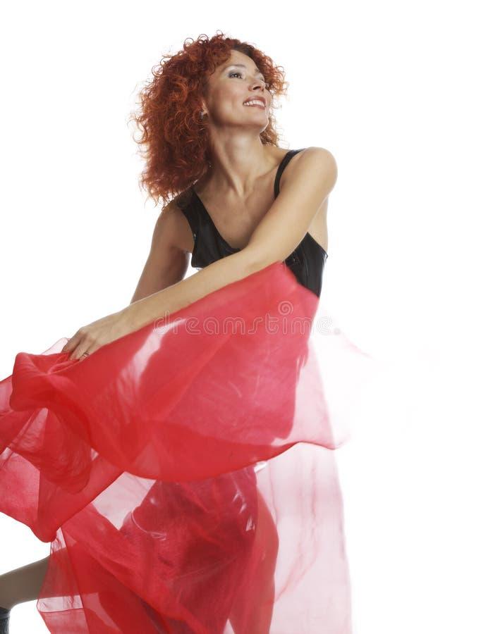 Het meisje met een rode sjaal stock fotografie