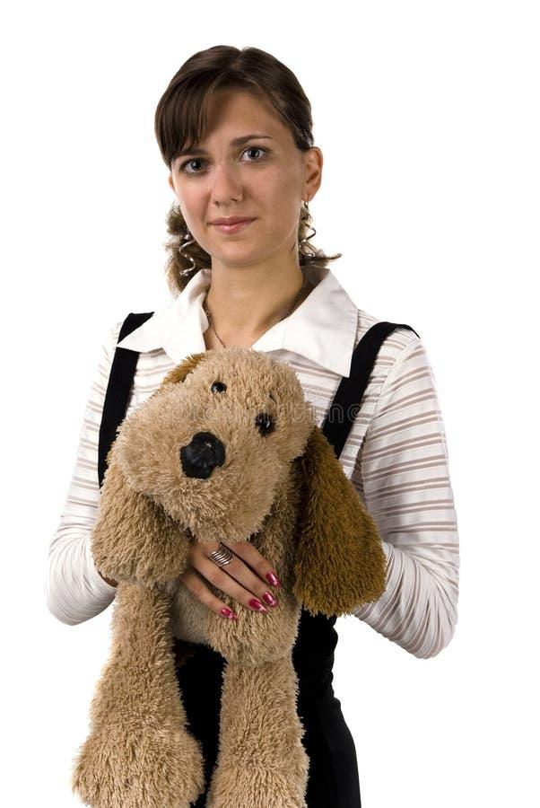 Het meisje met een stuk speelgoed hond stock afbeeldingen