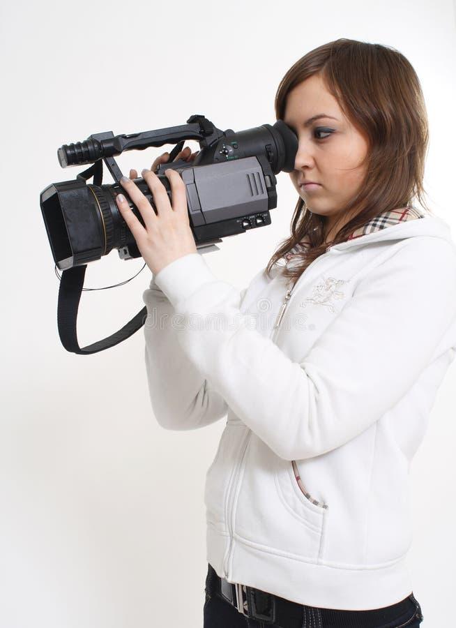 Het meisje met een videocamera stock fotografie