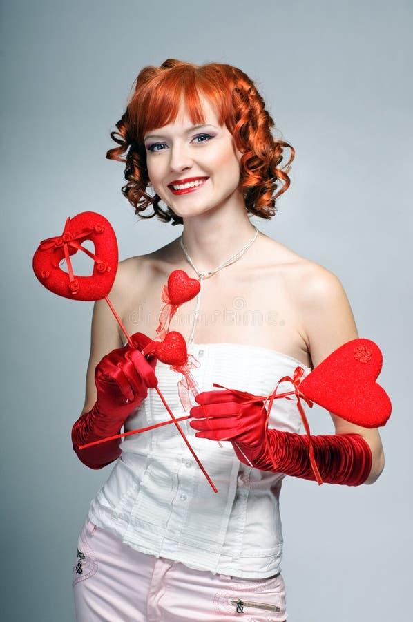 Het meisje met harten stock afbeelding