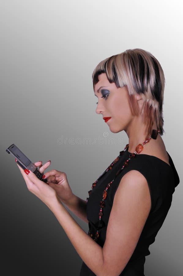 Het meisje met telefoon stock fotografie