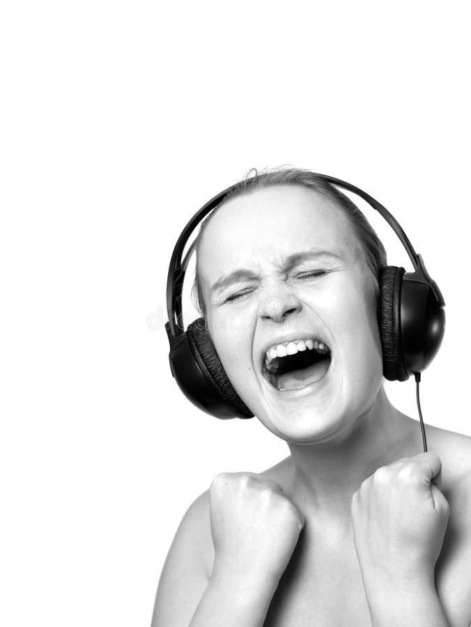 Het meisje in phoneheads schreeuwt emotioneel stock afbeelding