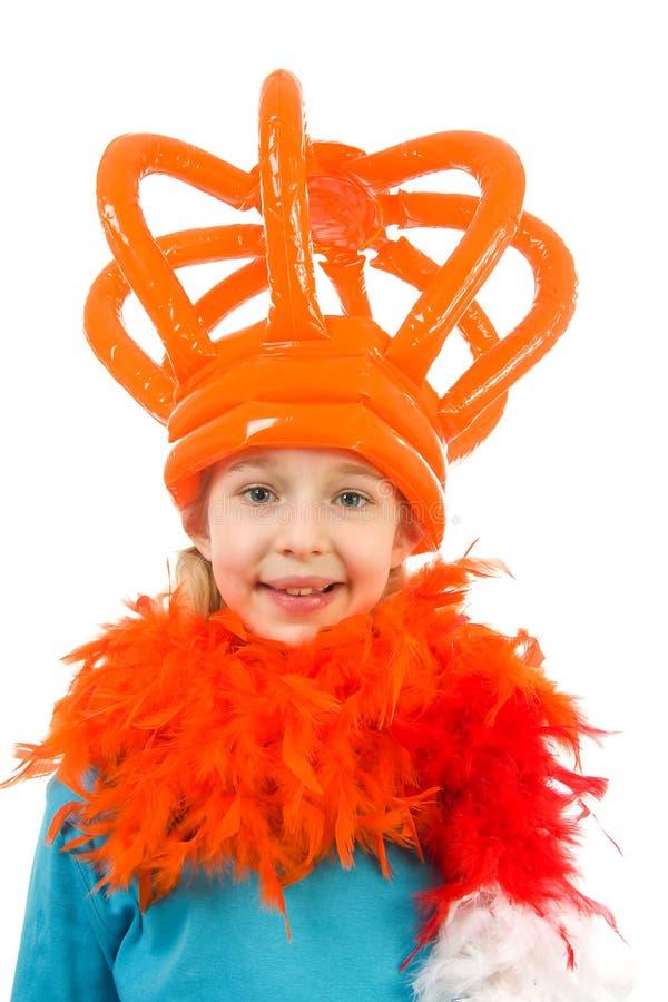 Het meisje stelt in oranje uitrusting stock afbeelding