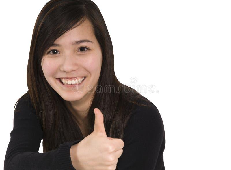 Het meisje toont duimen stock foto