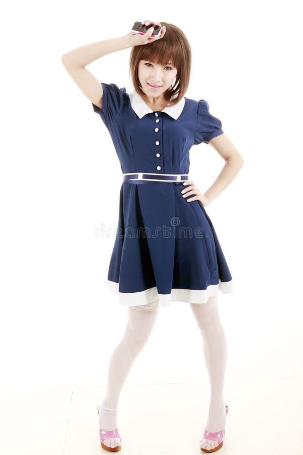 Het meisje van Azië met telefoon stock afbeelding