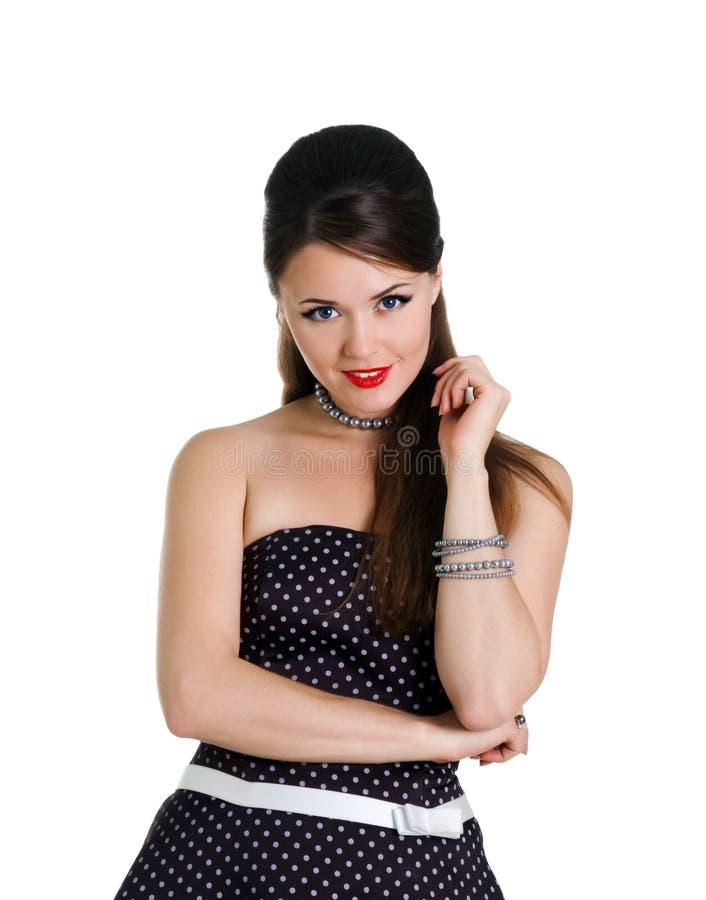 Het meisje van Beautyful in een retro kleding stock fotografie
