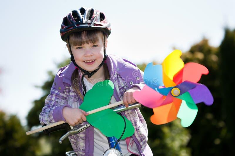 Het meisje van Biking stock foto's