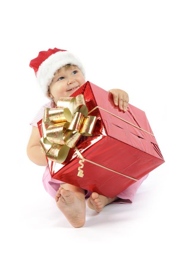 Het meisje van de baby in de hoed van de Kerstman royalty-vrije stock foto's
