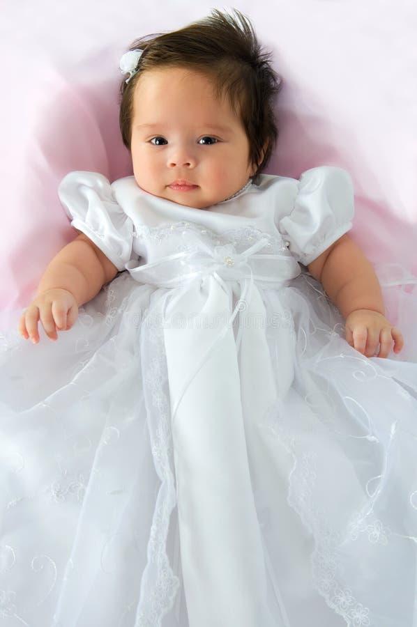 Het Meisje van de baby in de Kleding van het Doopsel stock foto's
