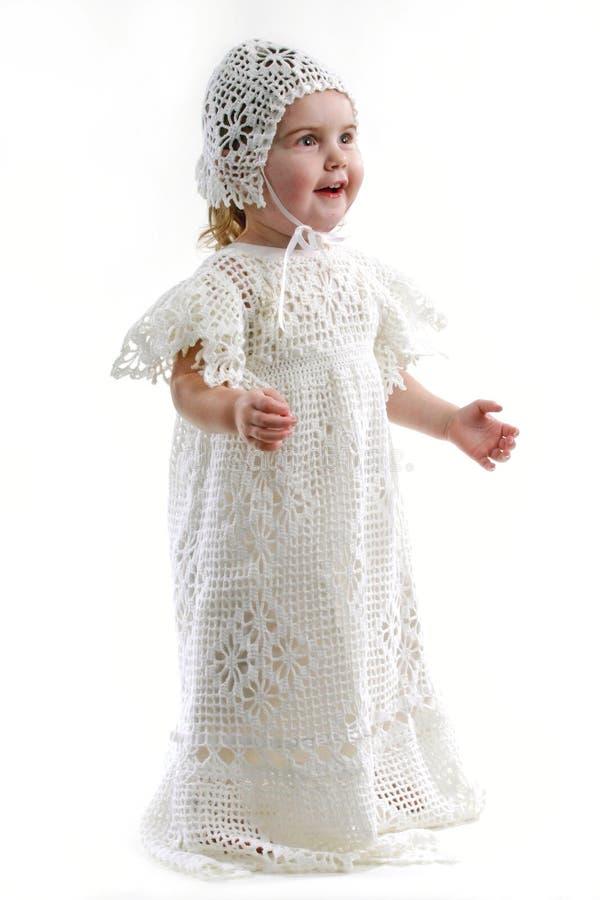 Het Meisje van de baby in de Toga van het Doopsel stock foto's