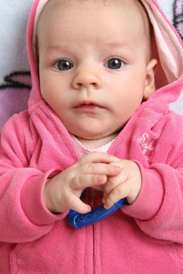Het meisje van de baby in een roze jasje royalty-vrije stock foto