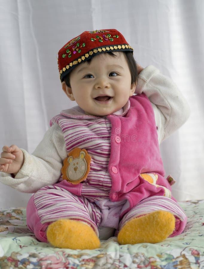 Het meisje van de baby in kleding Uigur royalty-vrije stock foto