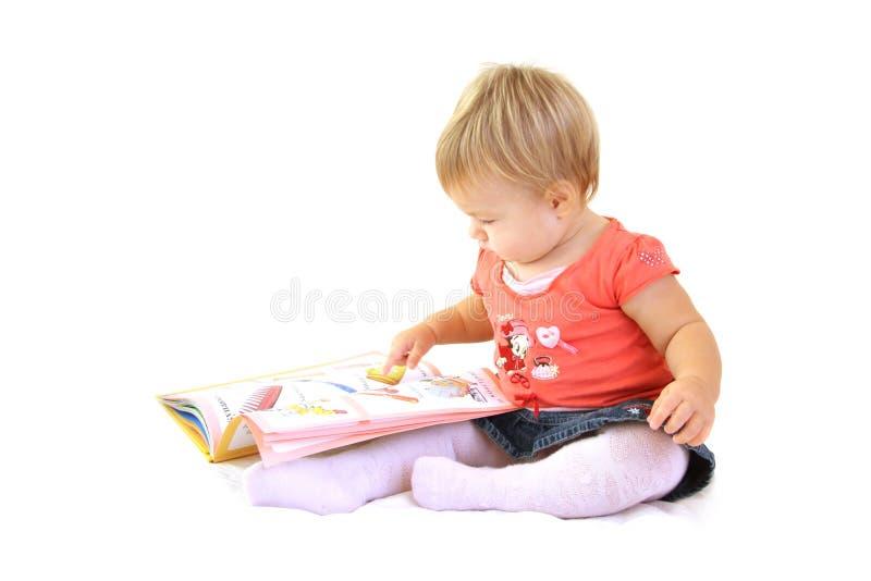 Het meisje van de baby met boek royalty-vrije stock fotografie