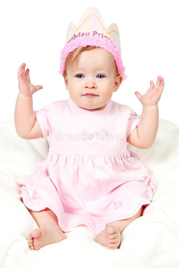 Het Meisje van de baby met de Hoed van de Verjaardag en hand op Lucht royalty-vrije stock fotografie