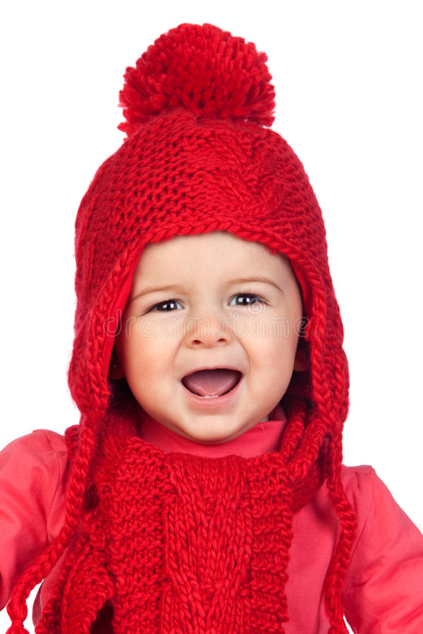 Het meisje van de baby met een grappige wol rode hoed stock afbeeldingen