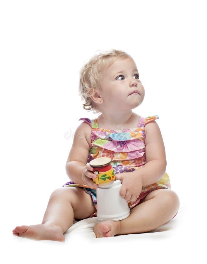 Het meisje van de baby met speelgoed royalty-vrije stock afbeelding