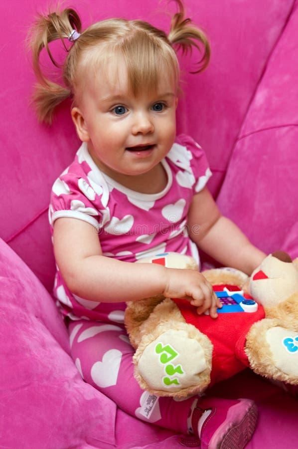 Het meisje van de baby in roze stock foto's