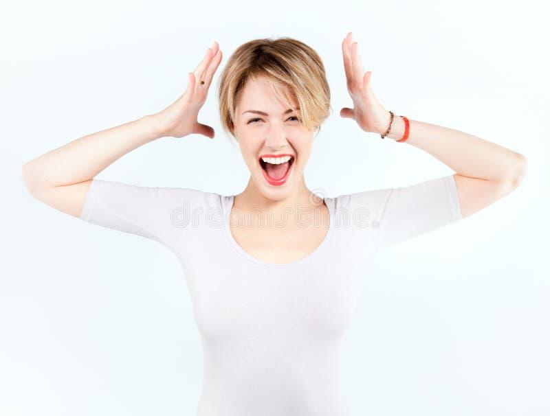 Het meisje van de blonde met geschokte uitdrukking stock foto