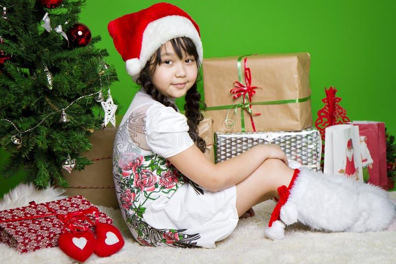 Het meisje van de kerstman stock foto's