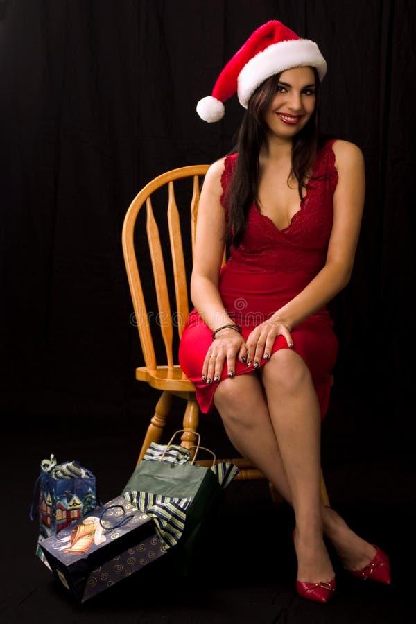 Het meisje van de kerstman na Kerstmis het winkelen stock afbeeldingen