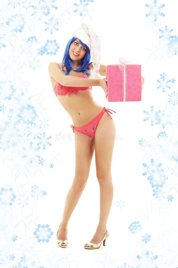 Het meisje van de kerstmanhelper op hoge hielen met sneeuwvlokken stock afbeeldingen
