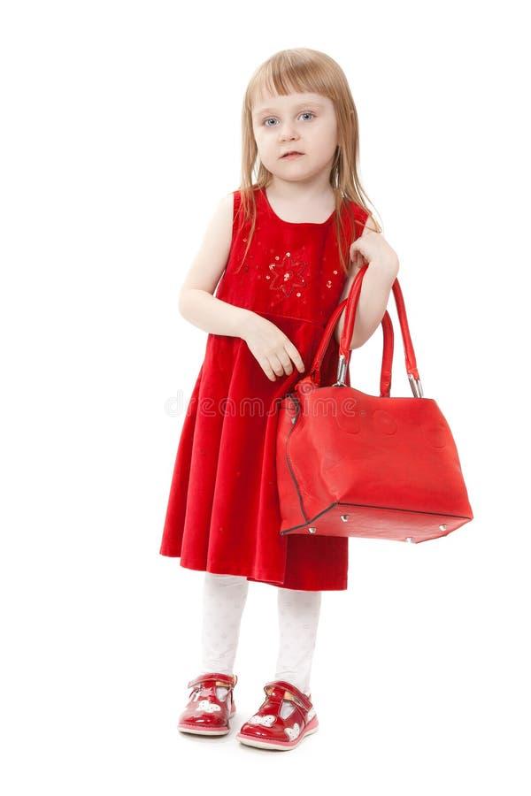 Het meisje van de manier met een rode handtas stock fotografie
