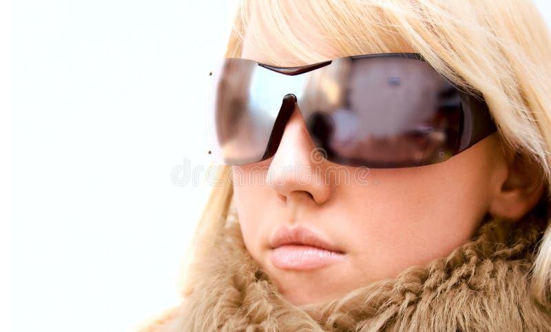 Het meisje van de manier met glazen stock foto's