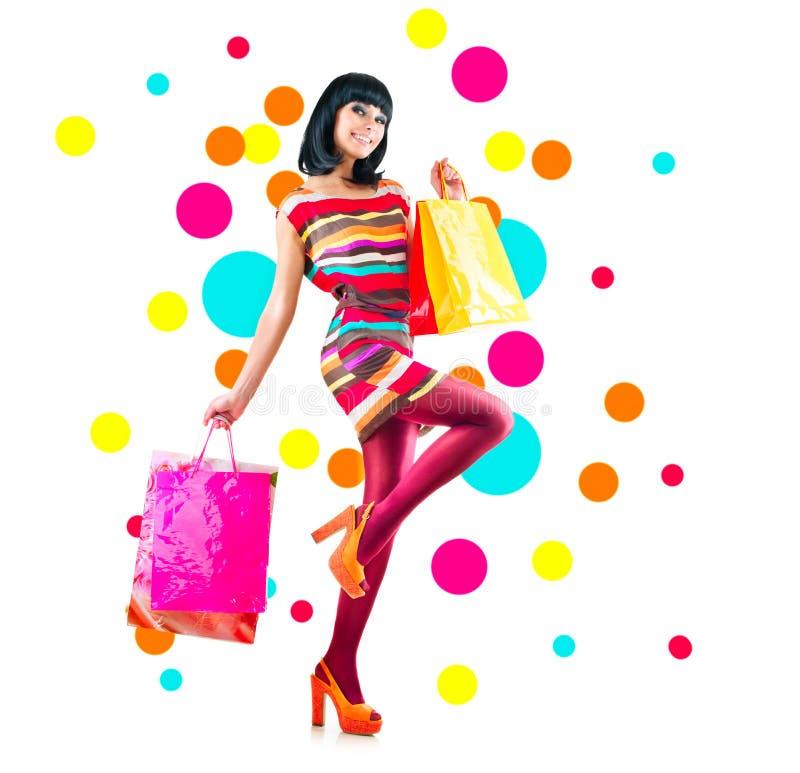 Het meisje van de manier met het winkelen zakken royalty-vrije stock foto