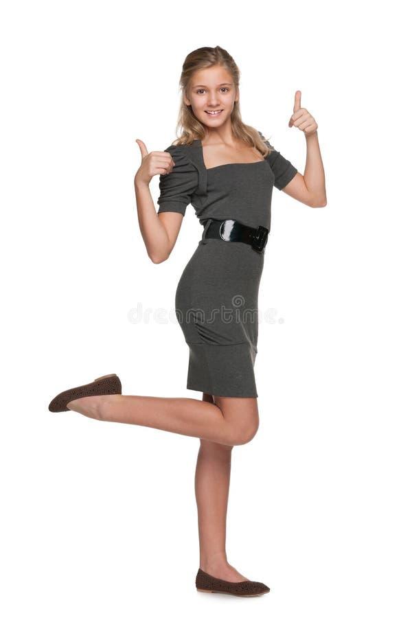 Het meisje van de maniertiener met haar omhoog duimen royalty-vrije stock foto's
