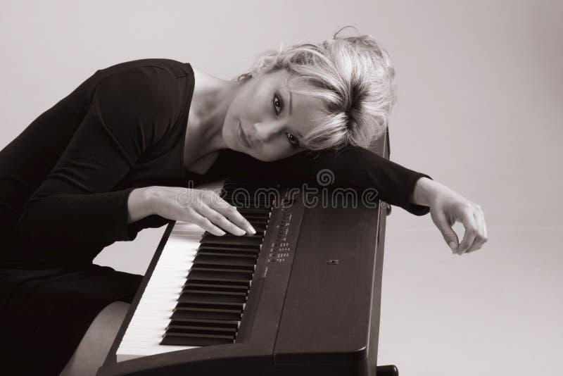 Het meisje van de muziek stock afbeelding