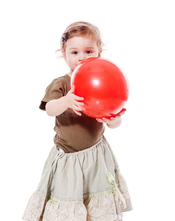 Het meisje van de peuter met ballon stock foto