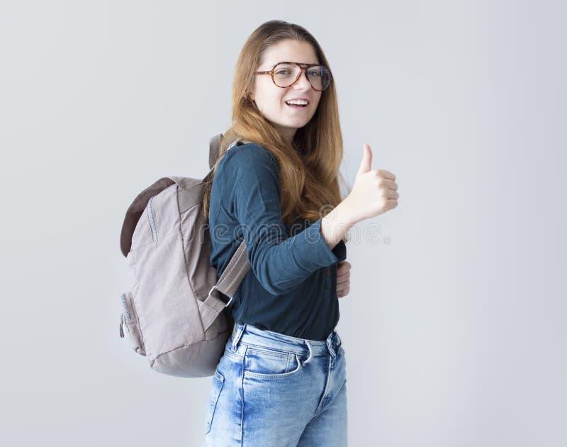 Het meisje van de portretstudent bekijkt camera stock fotografie