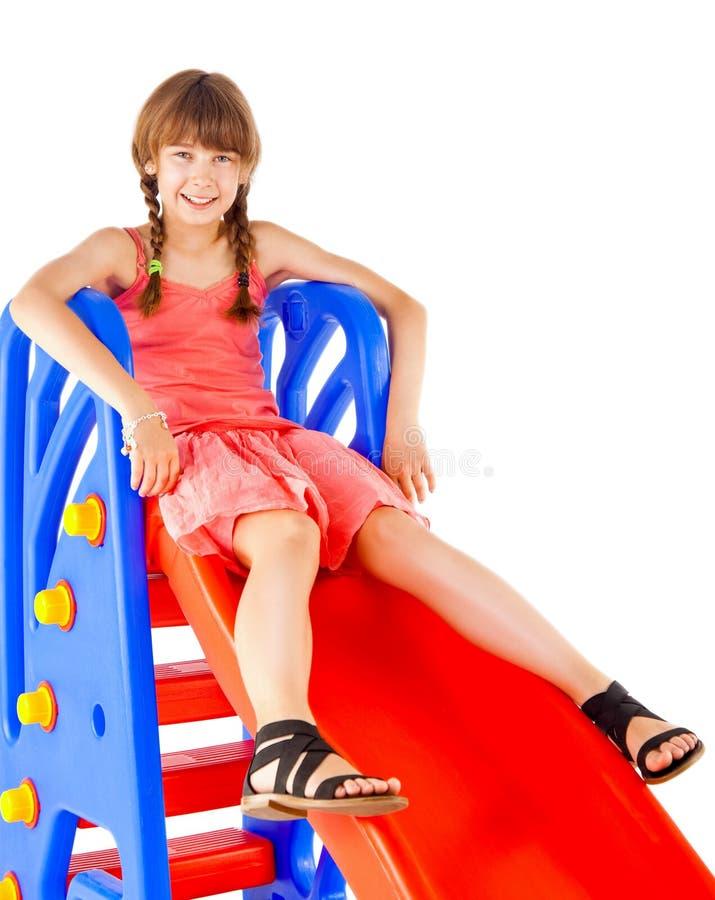 Het meisje van de roodharige op dia stock foto's