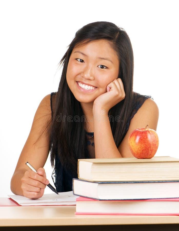 Het Meisje van de school bij Bureau stock afbeelding