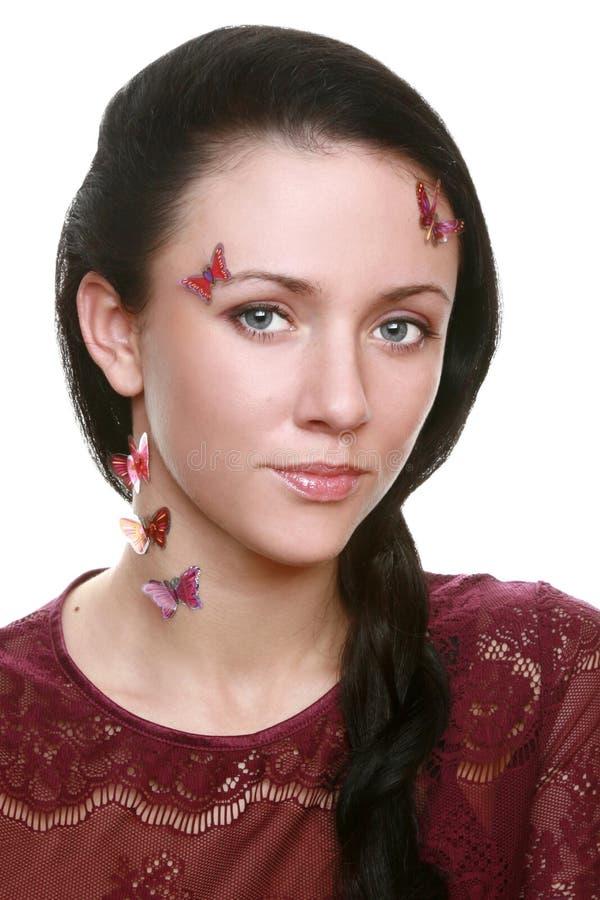 Het meisje van de schoonheid met vlinder op gezicht royalty-vrije stock foto